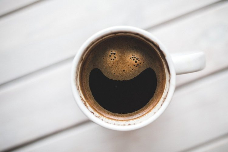 Cup of coffee from a clean coffee maker with a smiley face